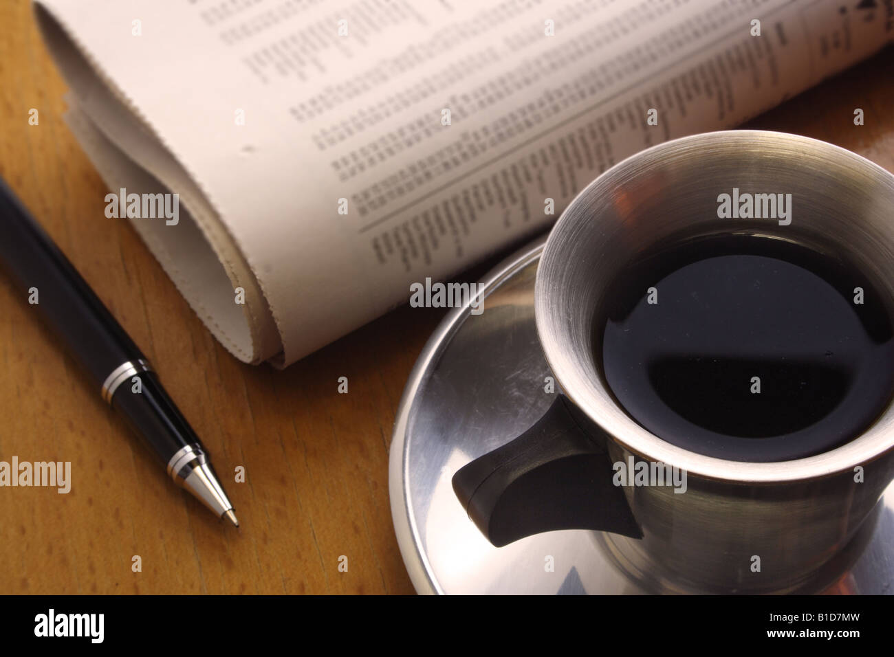 Black Coffee Pen and Newspaper Stock Photo