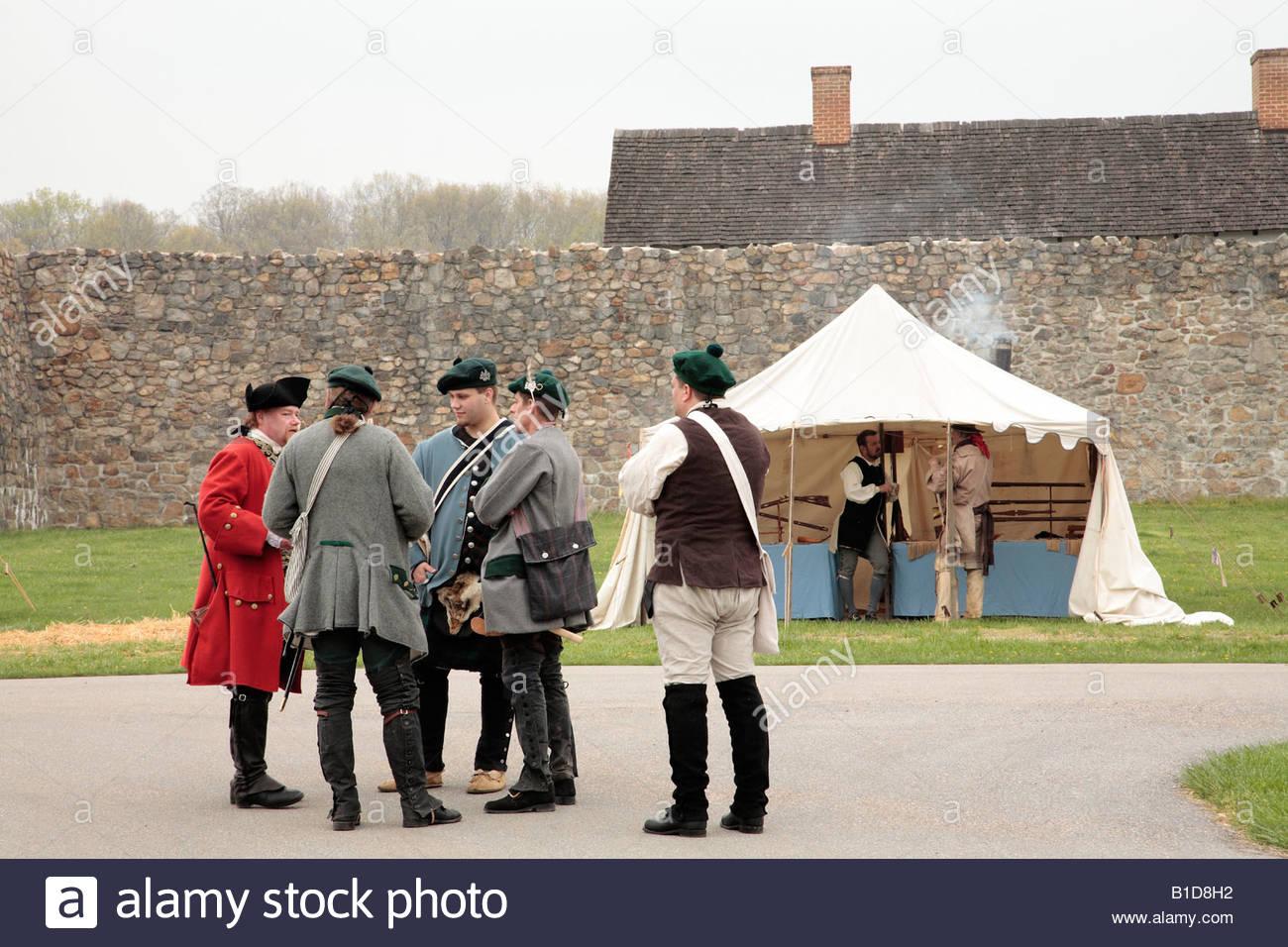 Reenactors gather near a sutler's booth at the Market Fair at an
