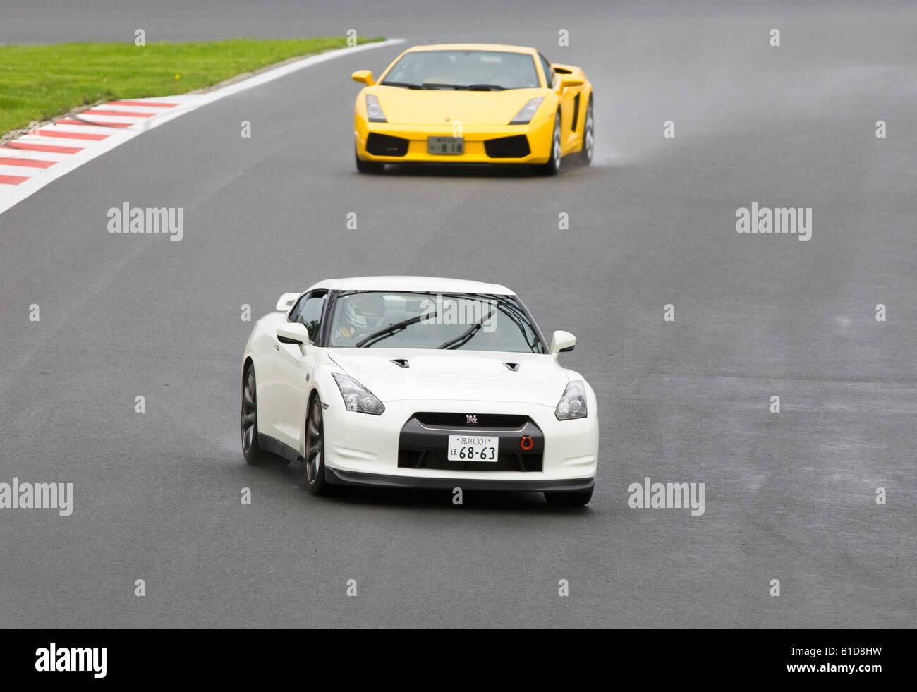 Yellow Lamborghini Gallardo Chasing A White Nissan Skyline Gtr At