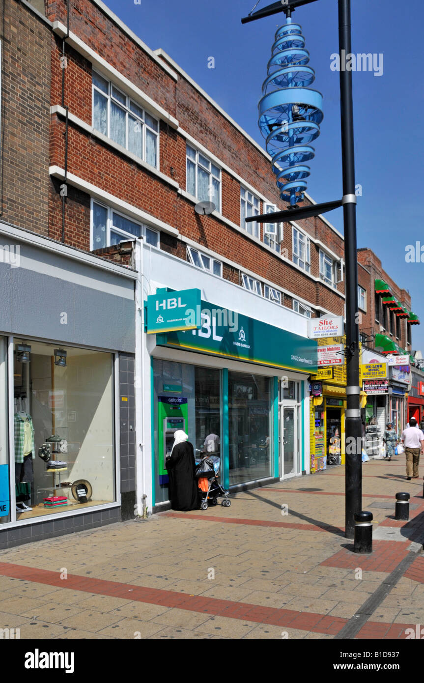 Upton Park Green Street shopping area  HBL bank with Lloyds TSB cash point machine ATM and lamp post spiral decoration - Stock Image
