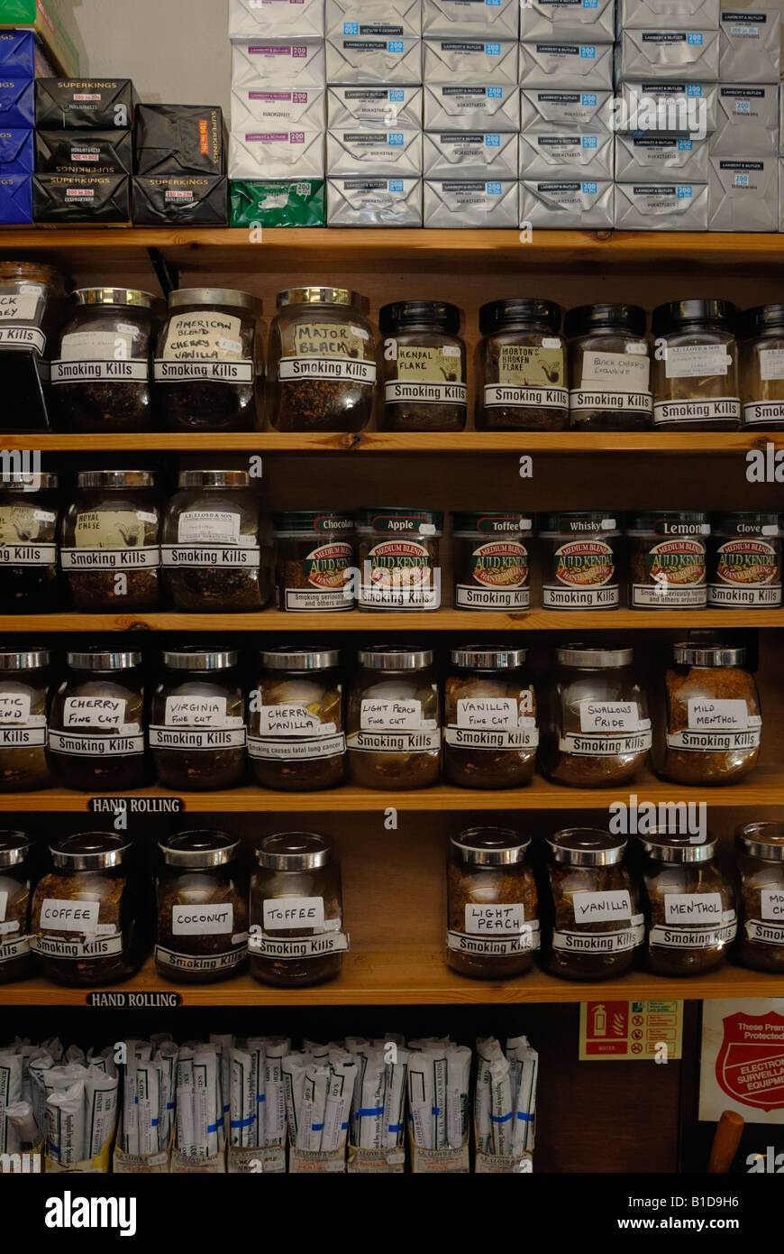 Selection of hand rolling and pipe tobaccos in jars in a Tobbaconists, Aberystwyth, Wales - Stock Image