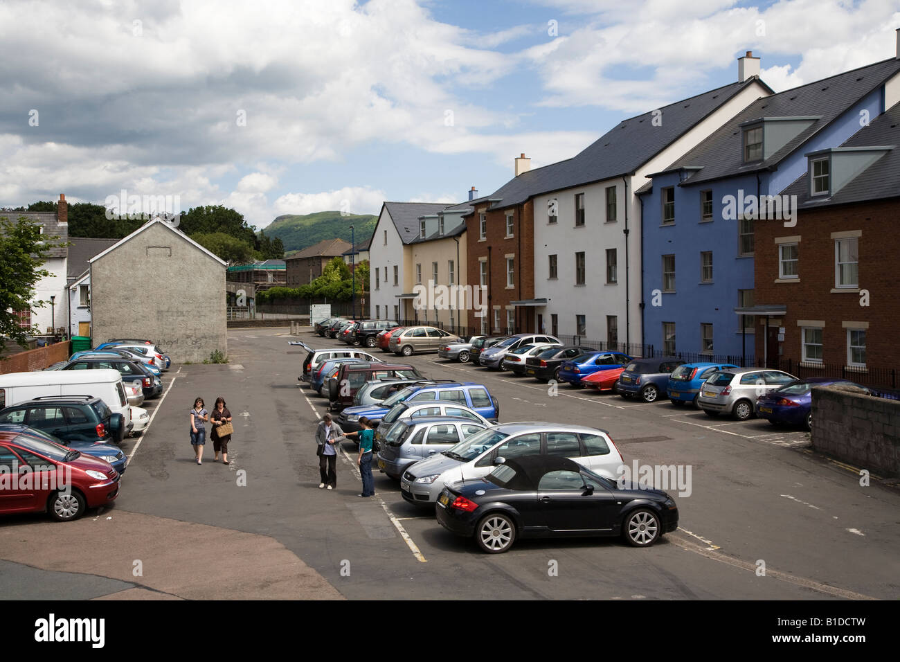 People in urban car park Abergavenny Wales UK - Stock Image