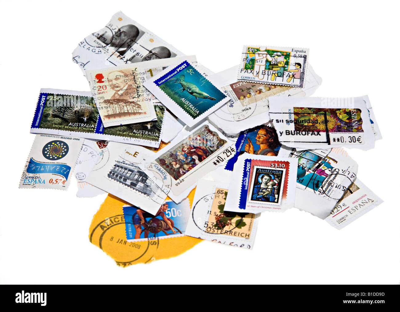 Mixture of franked used international postage stamps from variety of countries - Stock Image