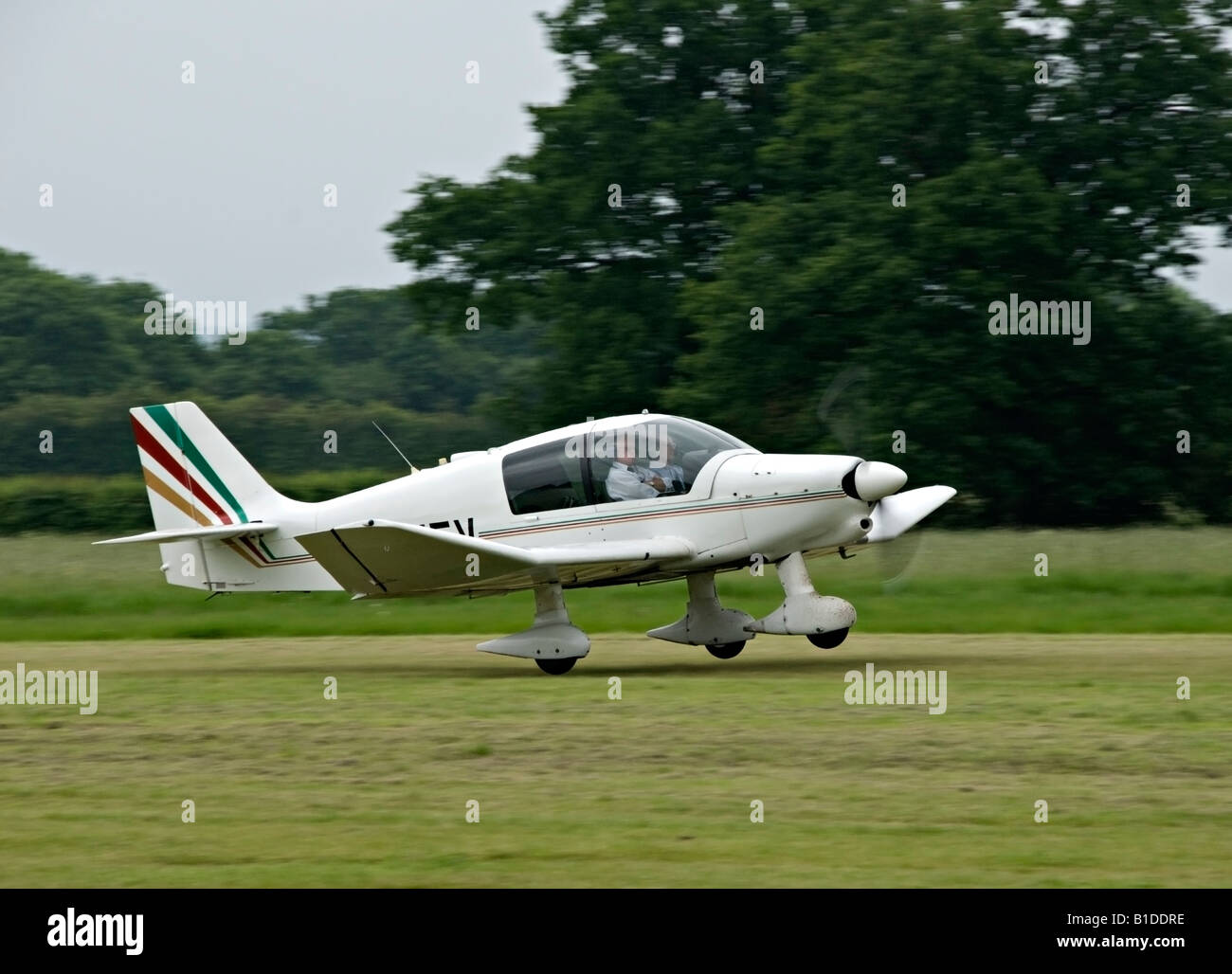 Robin light aircraft landing at Headcorn (Lashenden) aerodrome, Kent, England - Stock Image