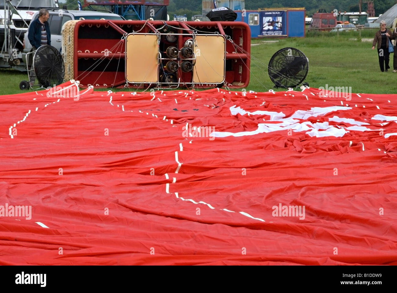 Preparations to inflate a hot air balloon at Headcorn (Lashenden) aerodrome - Stock Image