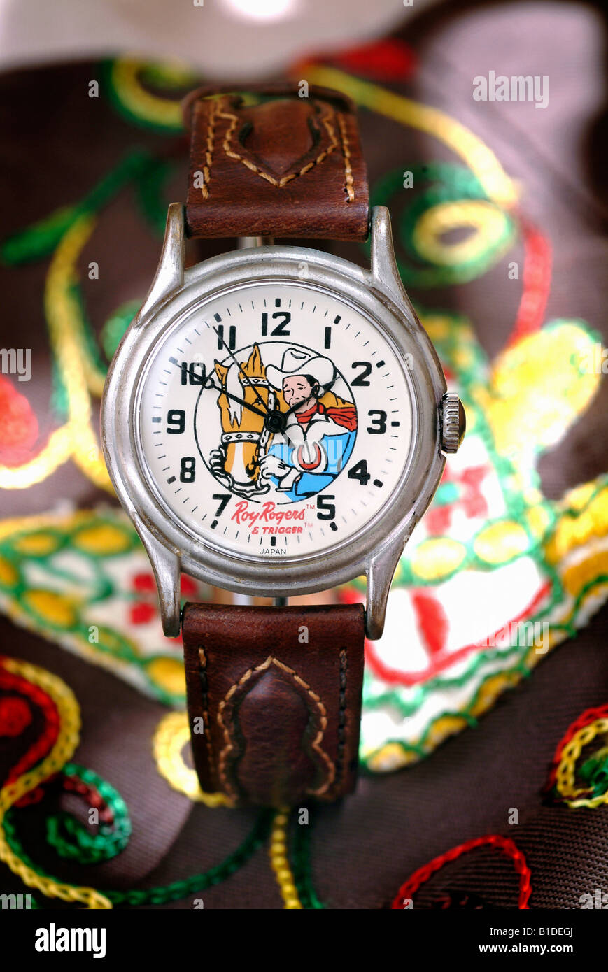 Vintage style collectible watch with a Roy Rogers, cowboy theme photographed on top of a Western shirt. Made by - Stock Image