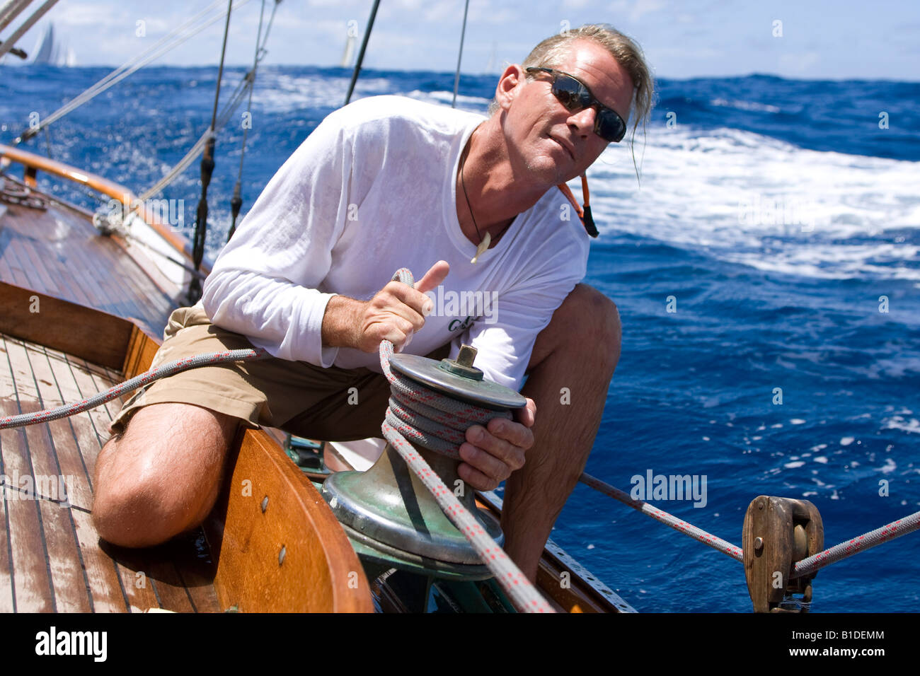 A crew member trims the head sail on board the sailing yawl SY Galatea in Antigua during the 2008 Antigua Classic - Stock Image