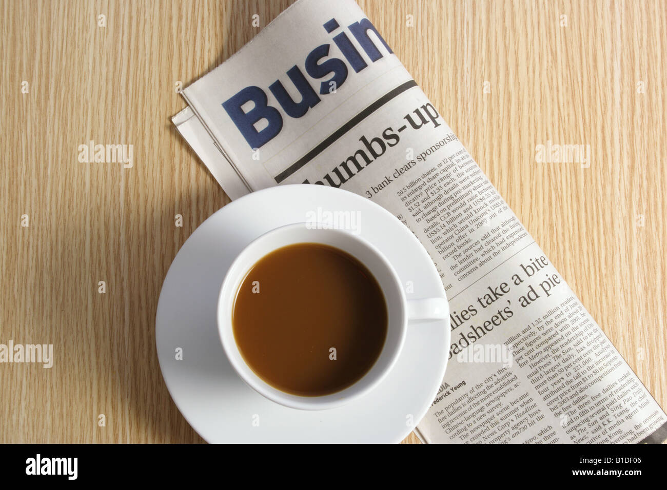 Coffee and newspaper on table Stock Photo