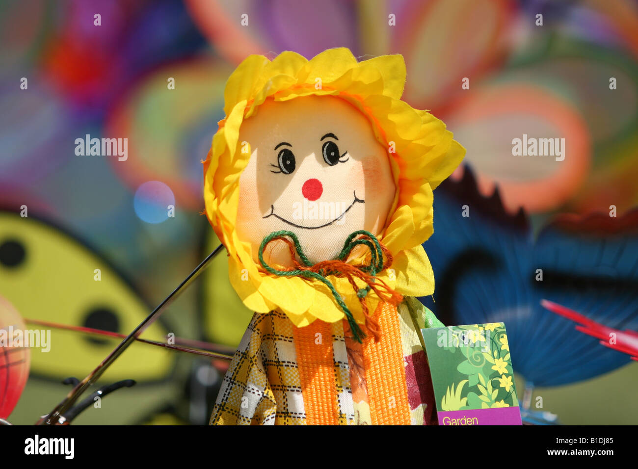 A doll and wind vanes at the Blackheath kite festival Lewisham London - Stock Image