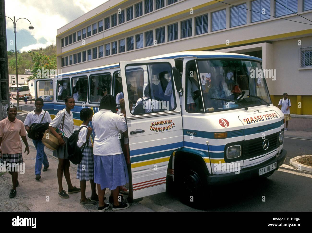 French students, schoolgirl, schoolgirls, boarding school bus, College Courbaril, school, Pointe-Noire, Basse-Terre, - Stock Image