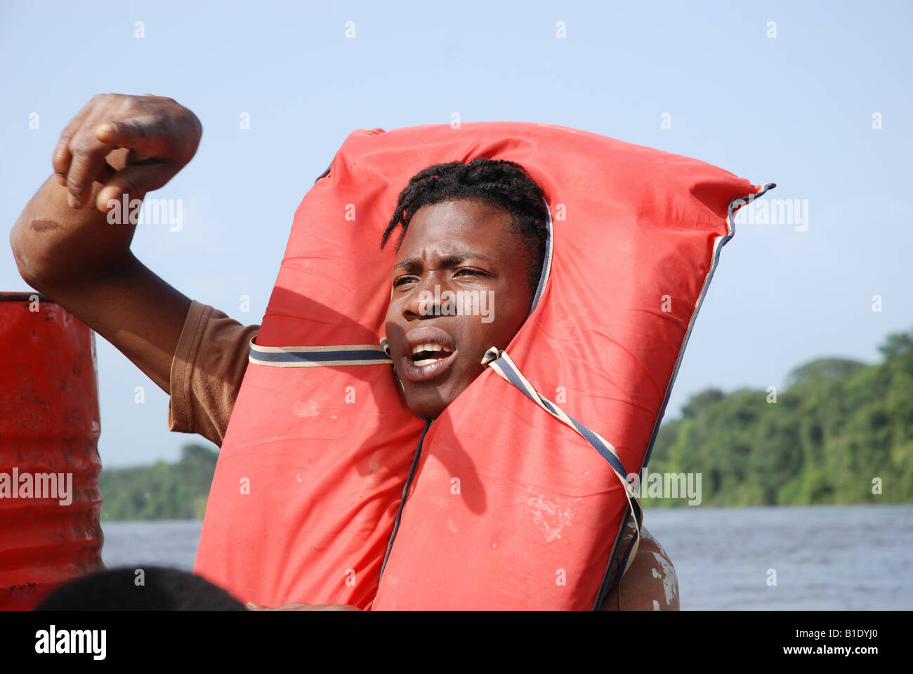 Down the Maroni river young black man with a life jacket around his head - Stock Image