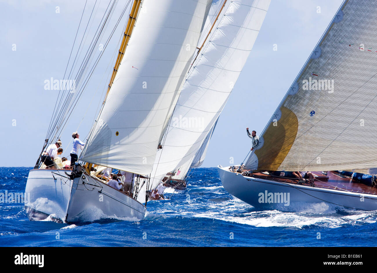 Two boats cross each other while approaching the mark during the Antigua Classic Yacht Regatta. A race for classic - Stock Image