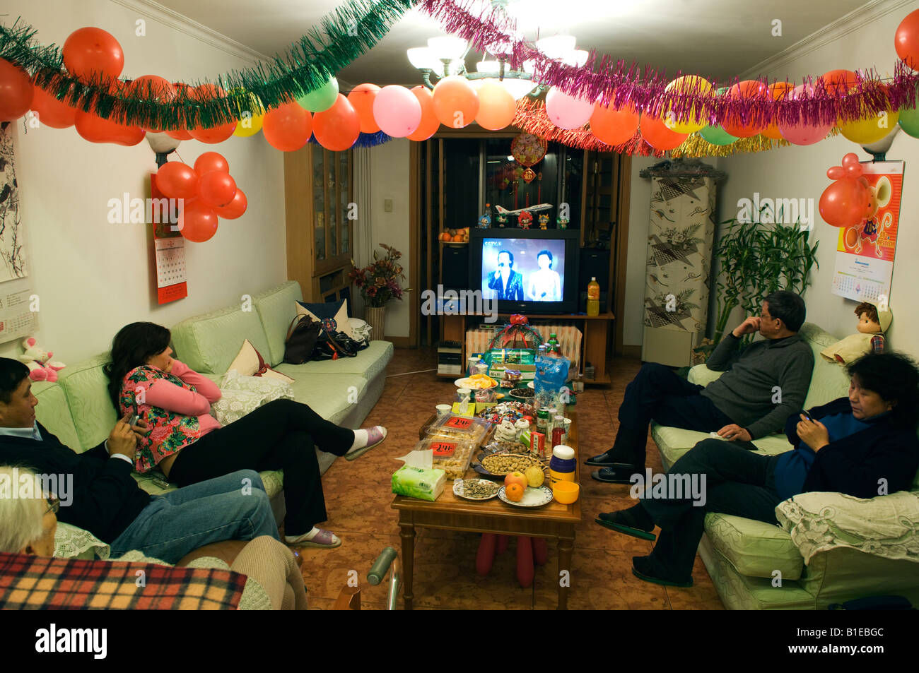 China Beijing Chinese New Year Spring Festival family dinner celebrations - Stock Image