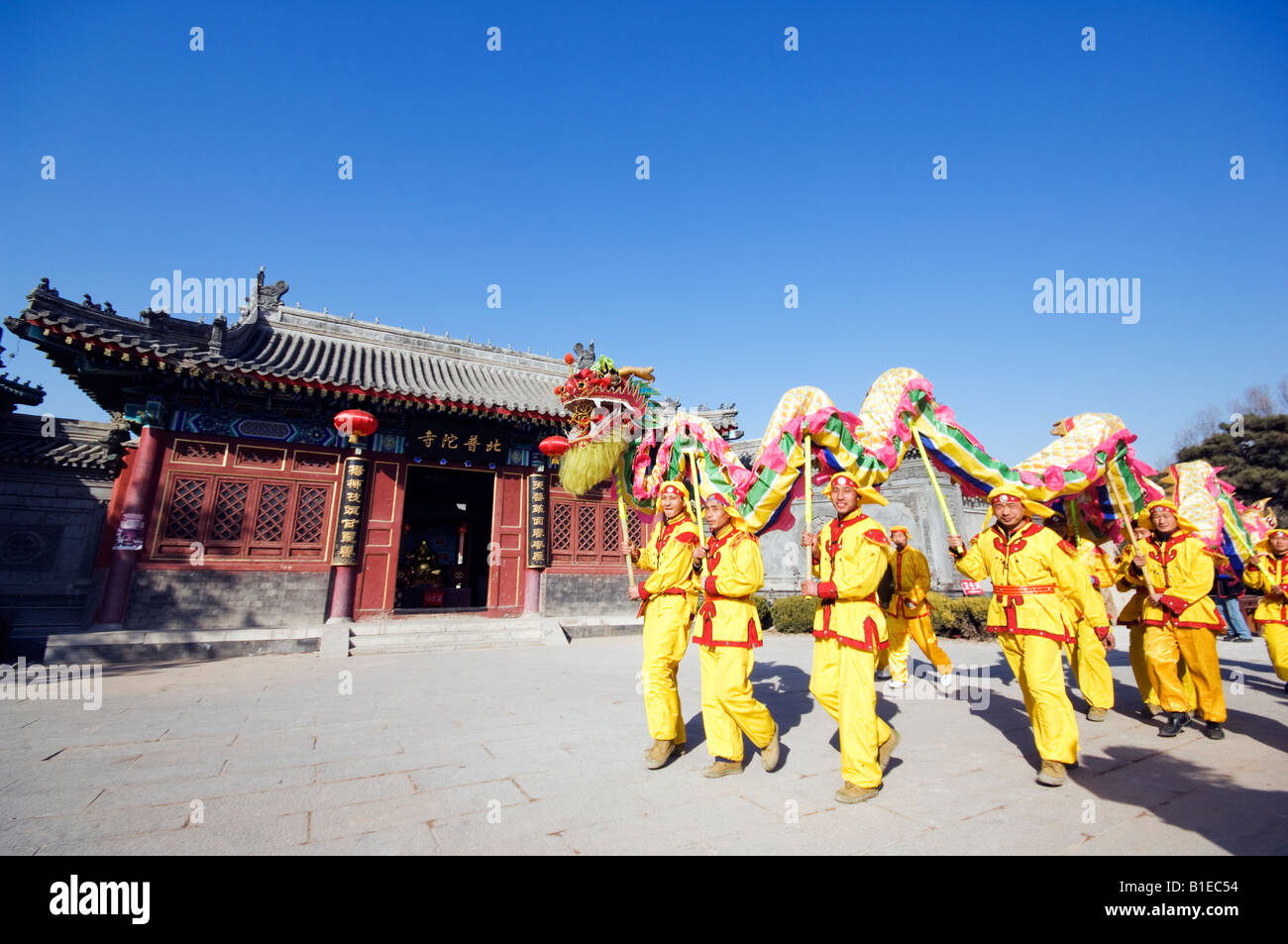 China Beijing Beiputuo temple and film studio Chinese New Year Spring Festival Dragon Dance performers - Stock Image
