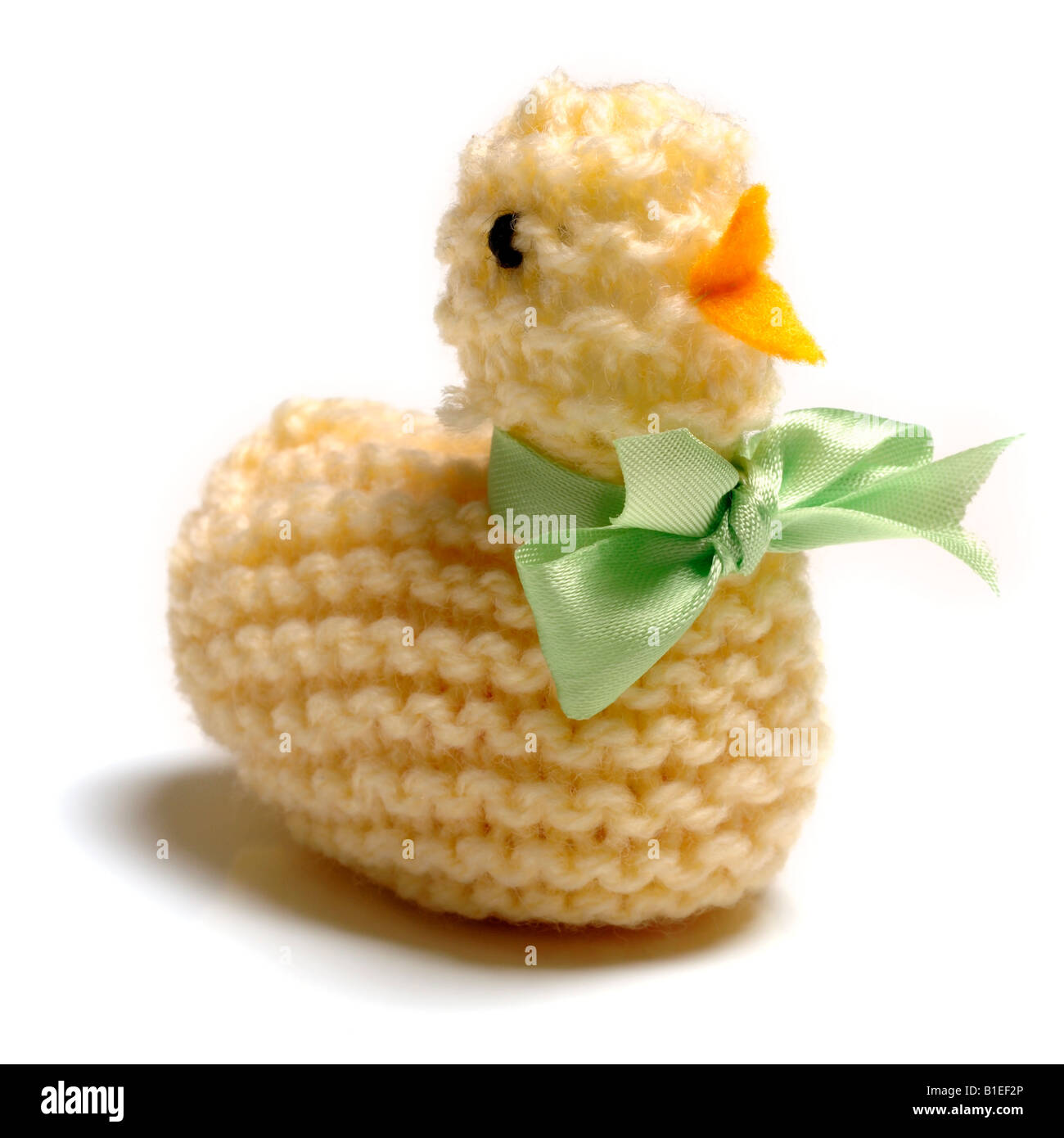 yellow knitted easter chick - Stock Image