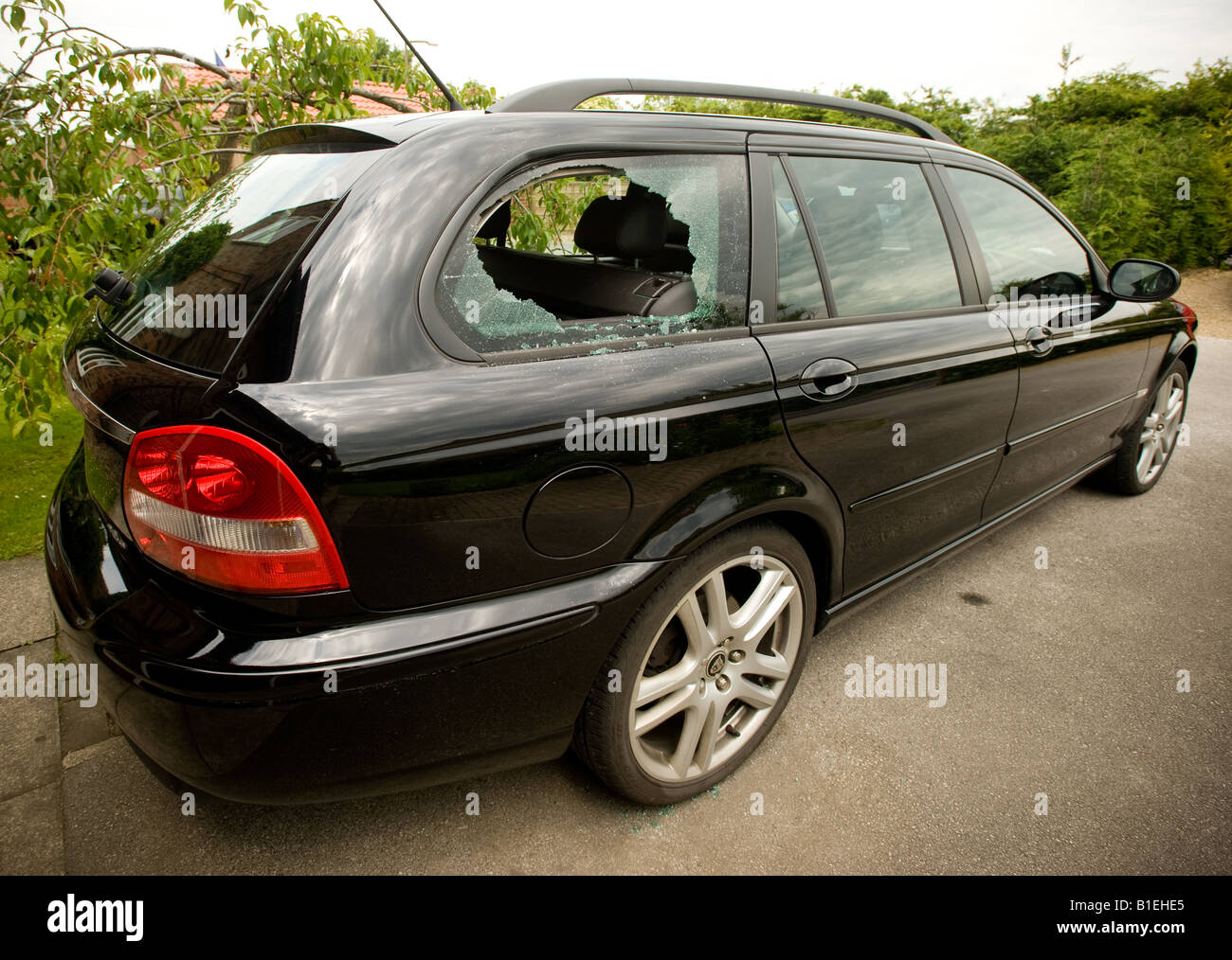 Smashed rear car window - Stock Image