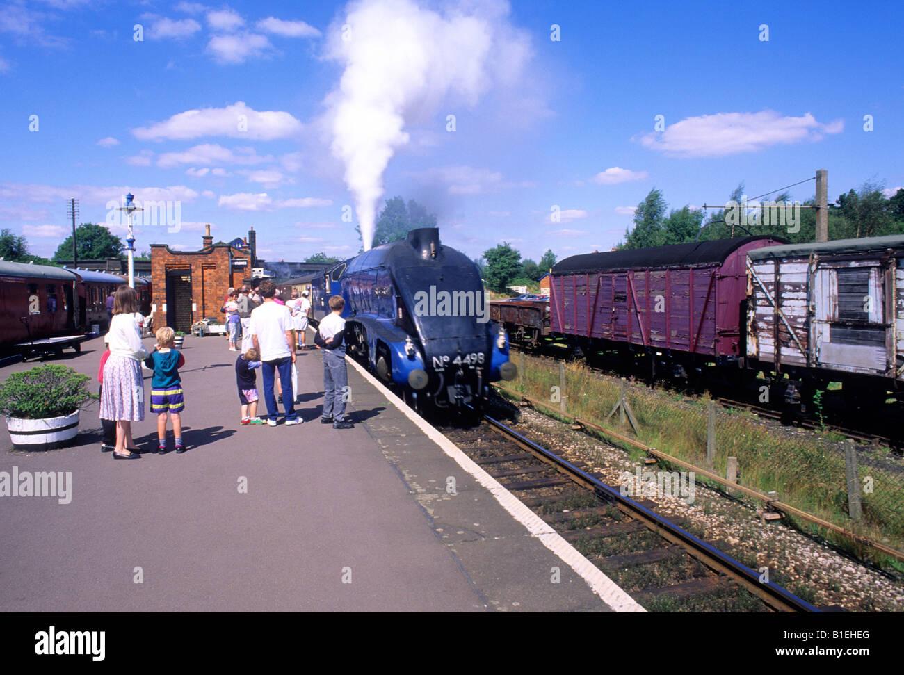 Rothley Leicestershire Sir Nigel Gressley people steam train engine platform blue streamline transport vintage England - Stock Image