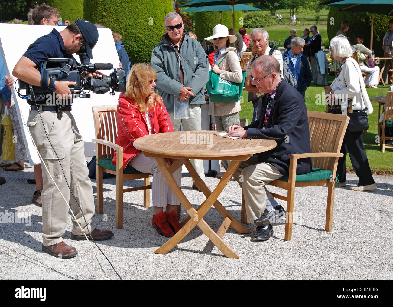 a member of the public having an item valued by an expert at the bbc television programme the antiques roadshow - Stock Image