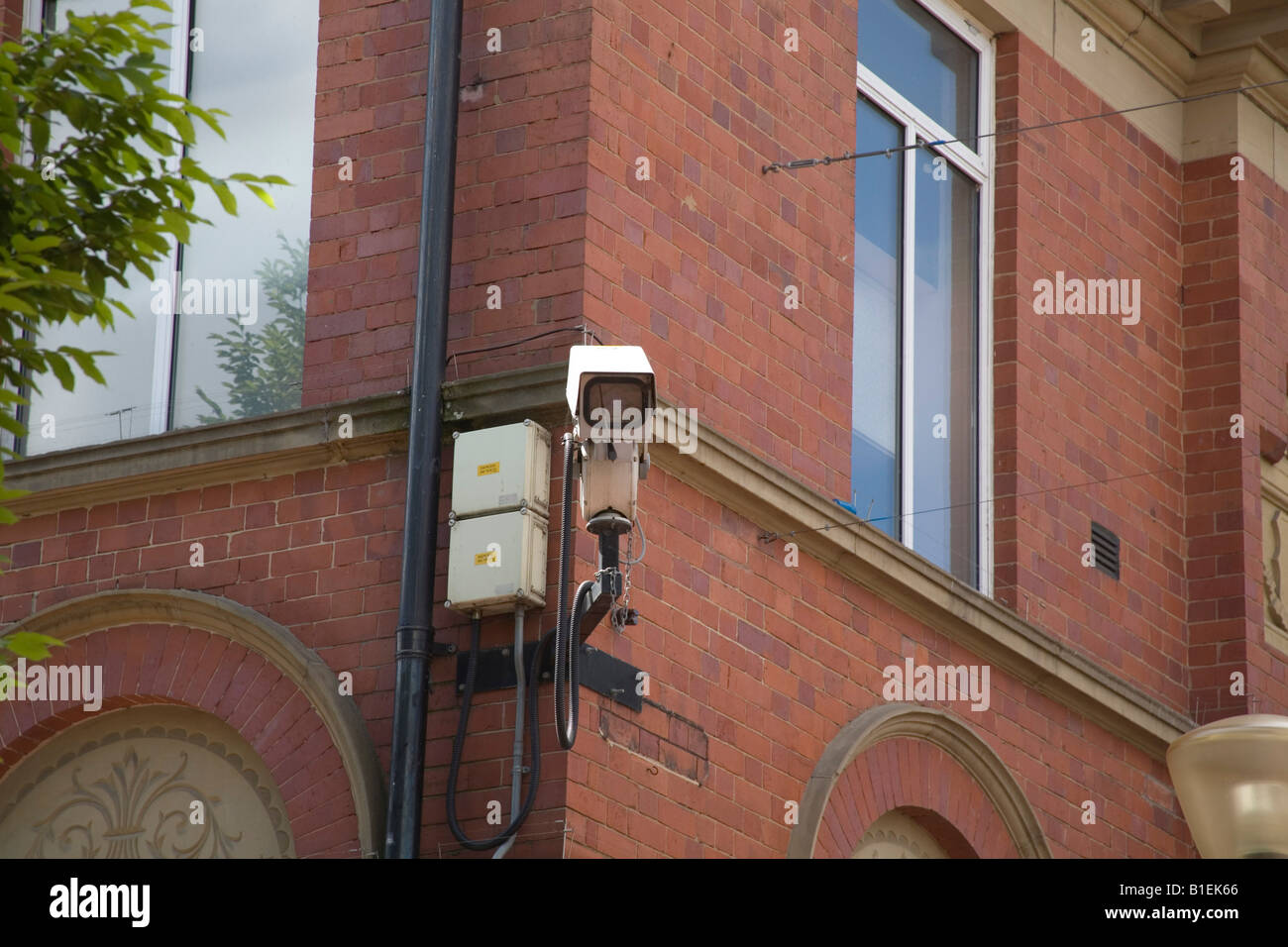UK June Close Circuit TV scanning a town centre for safety and pedestrian protection crime prevention - Stock Image