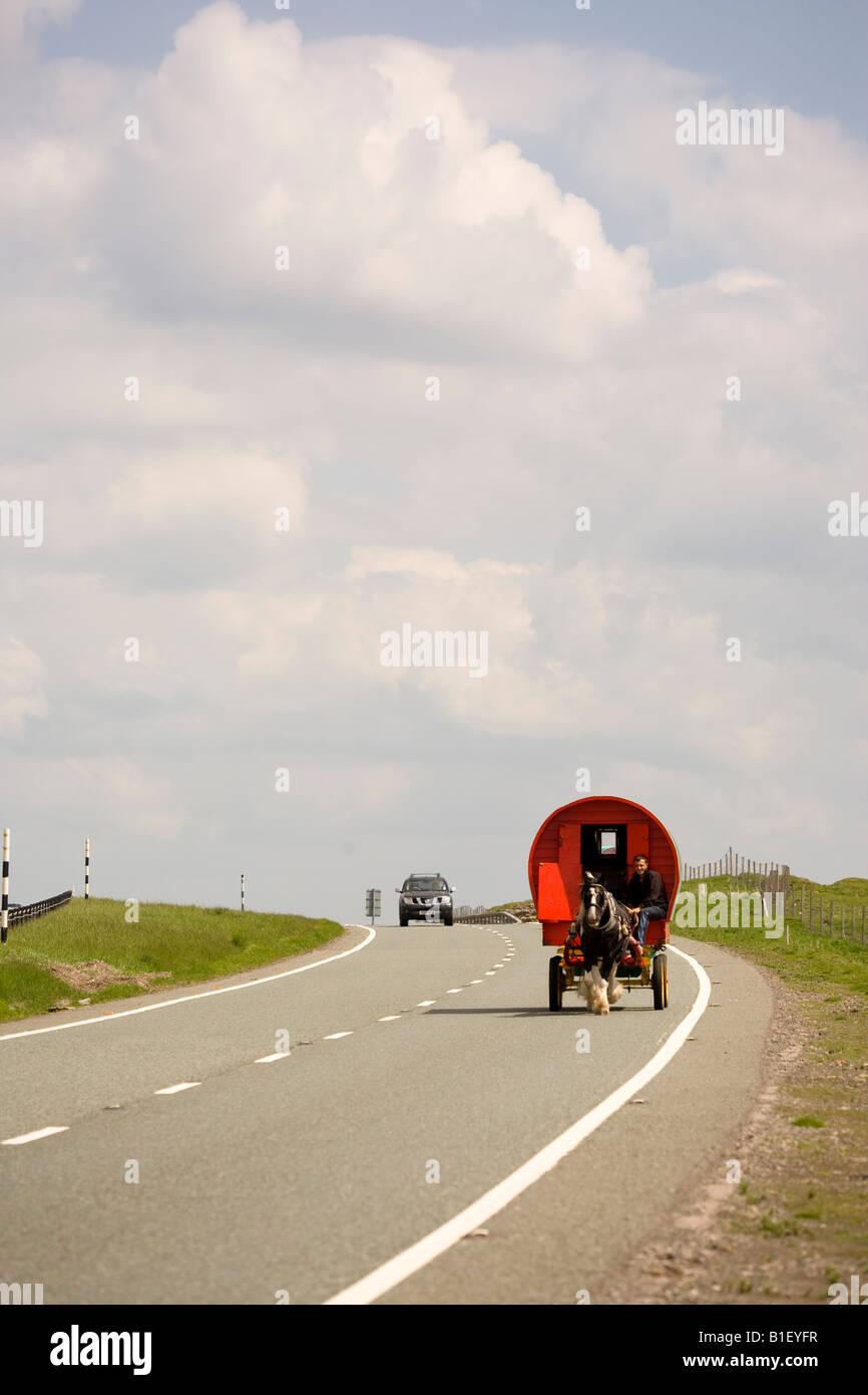 Caravan on the A66 en route to the Appleby Horse Fair - Stock Image