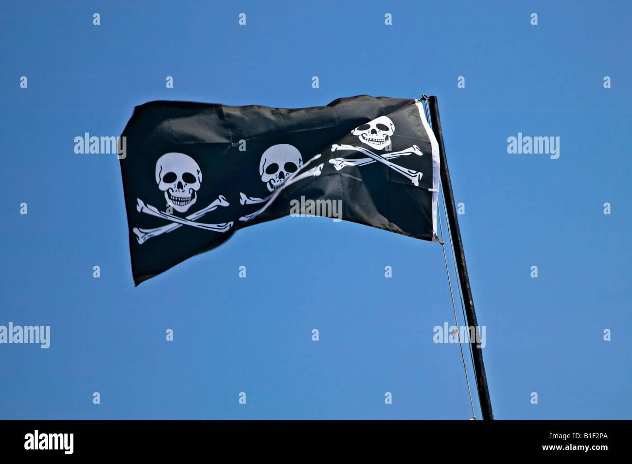 Three skulls and cross bones flag - Stock Image