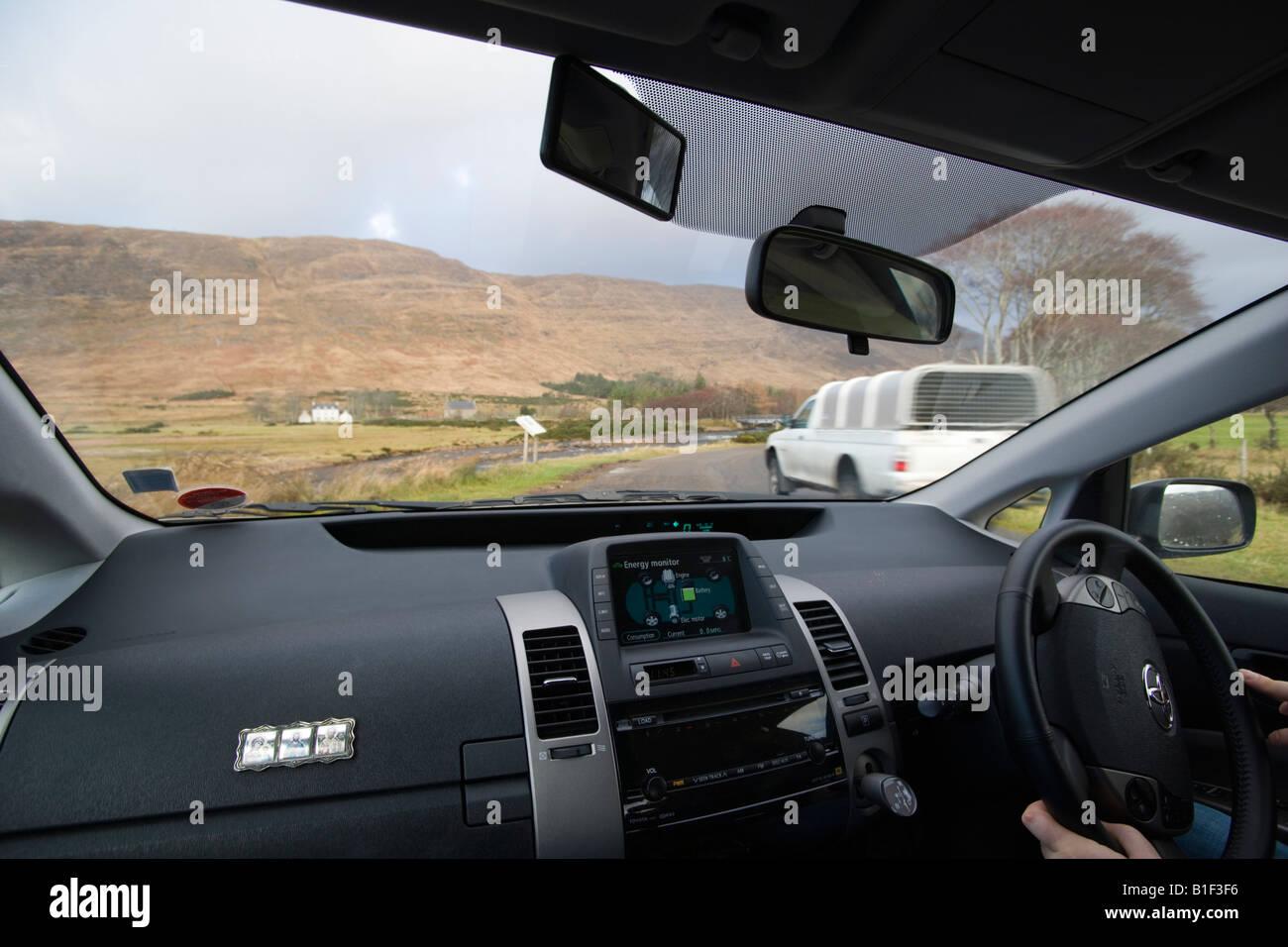 https://c8.alamy.com/comp/B1F3F6/toyota-prius-interior-driving-in-highlands-scotland-uk-B1F3F6.jpg