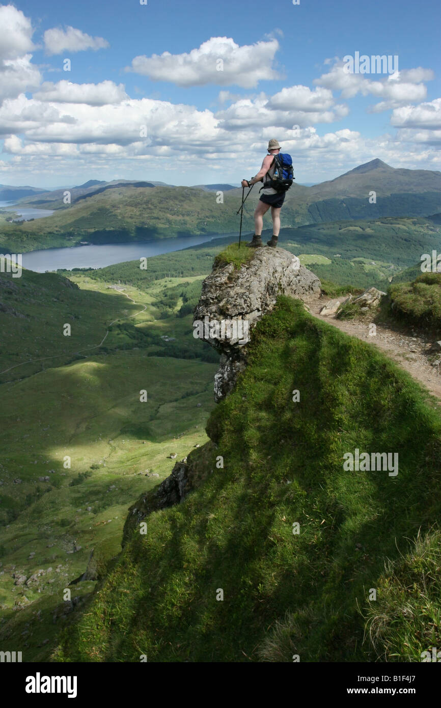 Hiker looking out across Loch Lomond and Trossachs National Park from Ben Vane - Stock Image