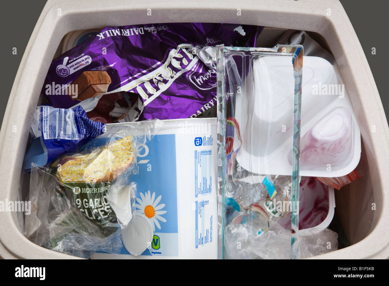 Single-use plastic household rubbish thrown out in waste bin from above. England UK Britain - Stock Image