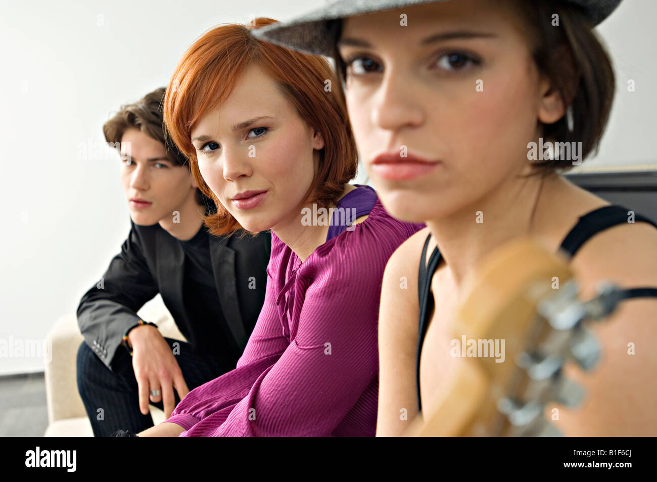 Portrait of two young women with a teenage boy - Stock Image