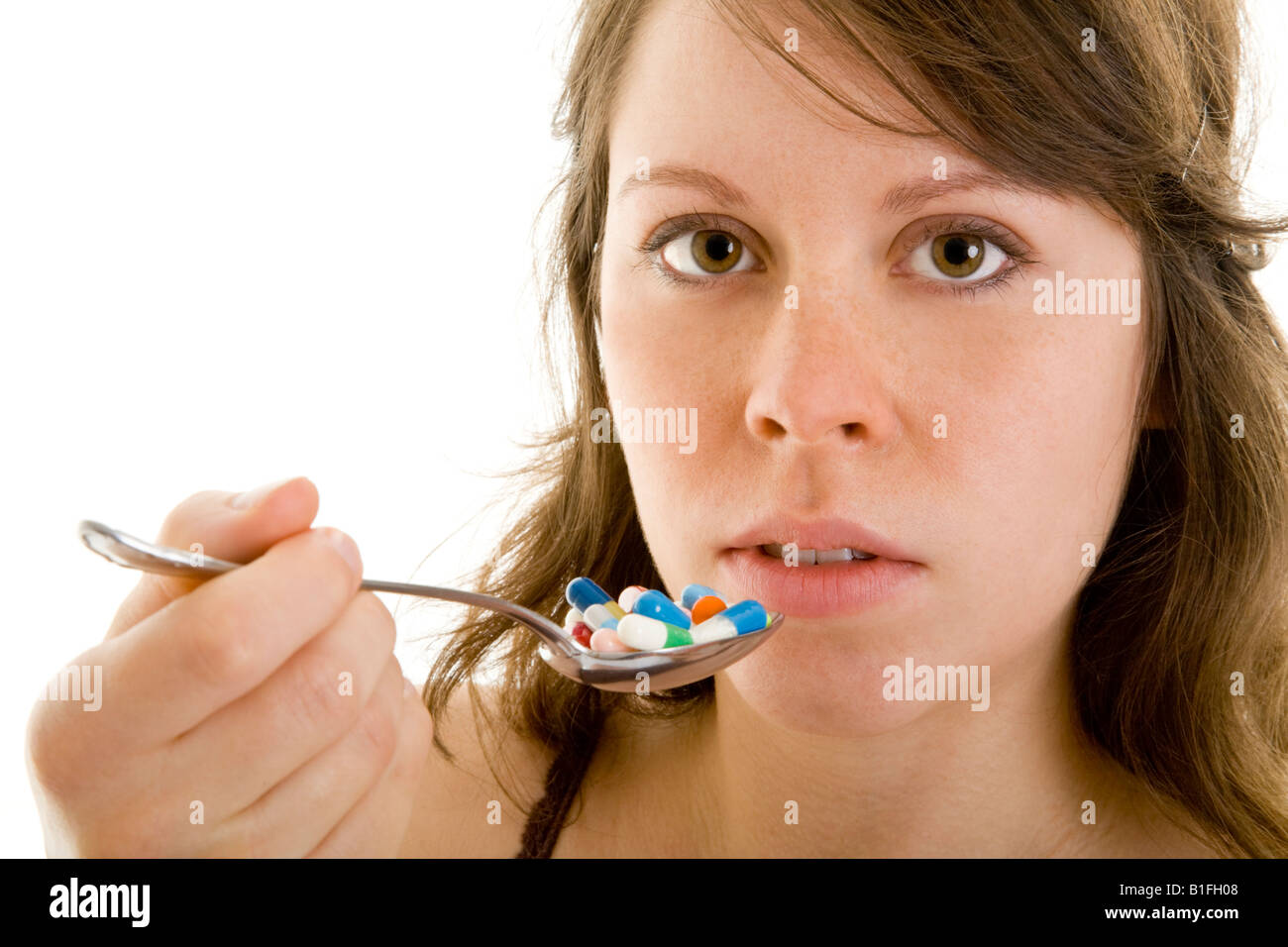 young brunet girl with diverse tablets Stock Photo