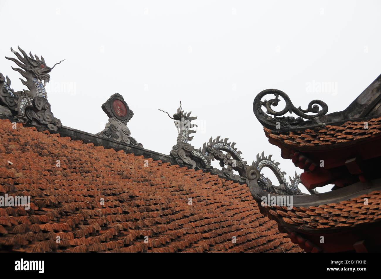 Roof detail showing dragons One pillar Pagoda Hanoi Vietnam Stock Photo