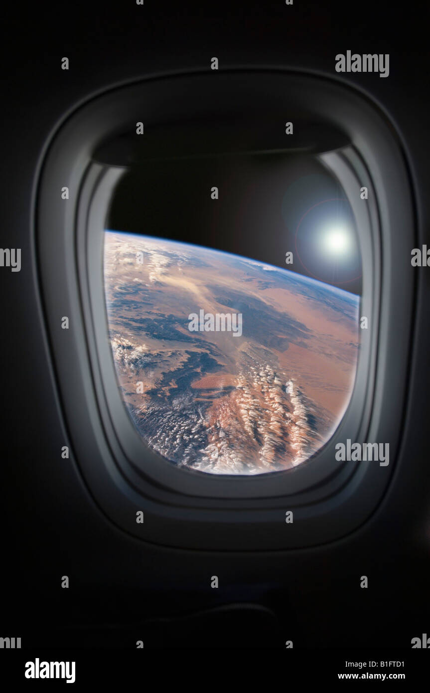 View of earth from spacecraft window - Stock Image