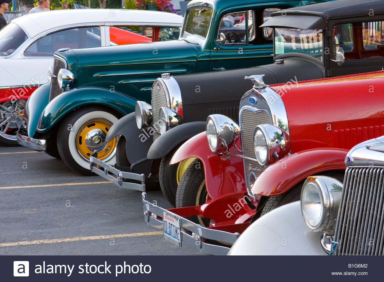 Vintage automobiles in a parking lot viewed from a public right of ...