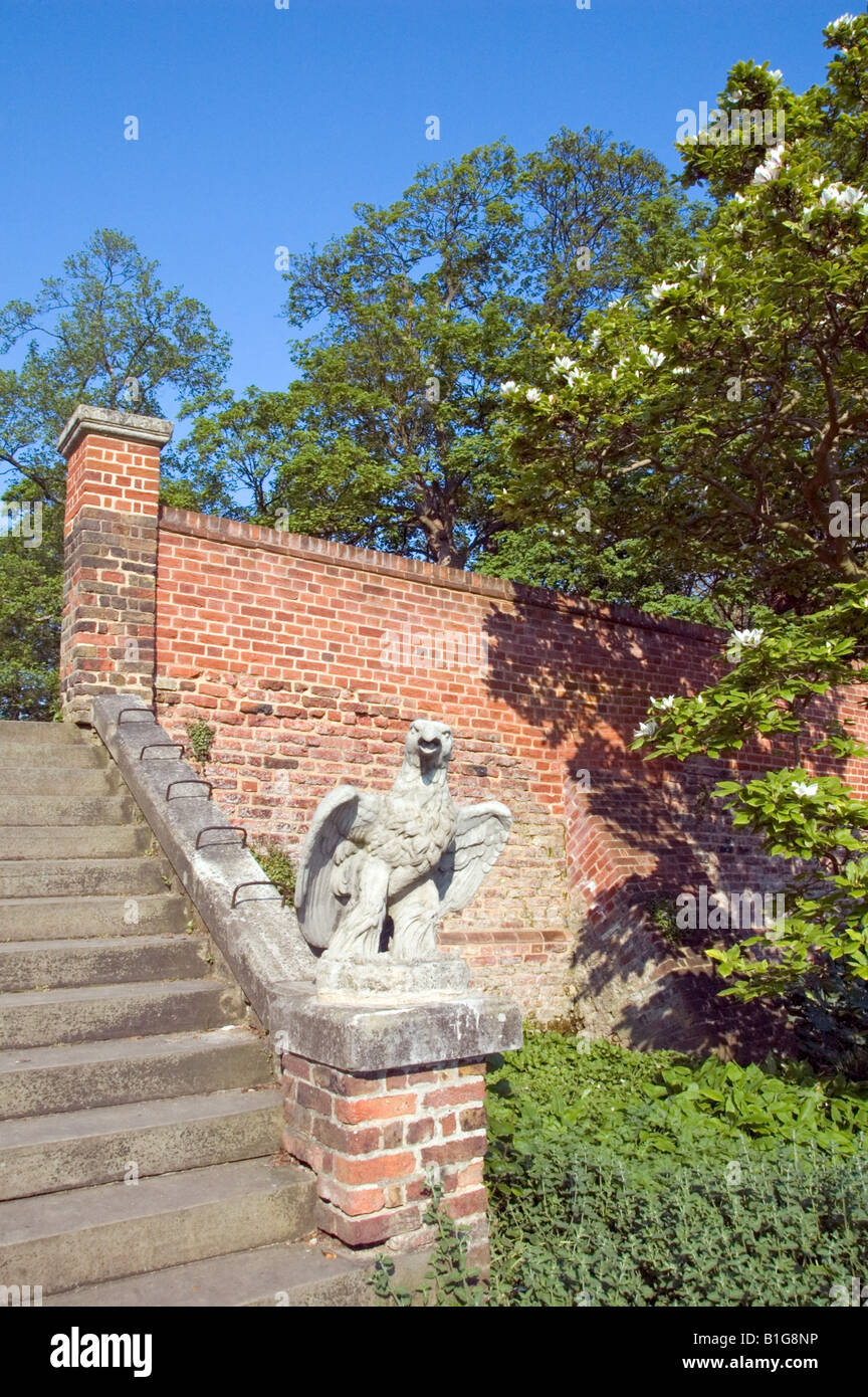 Stone statue of eagle on steps Waterlow Park Highgate London England UK - Stock Image