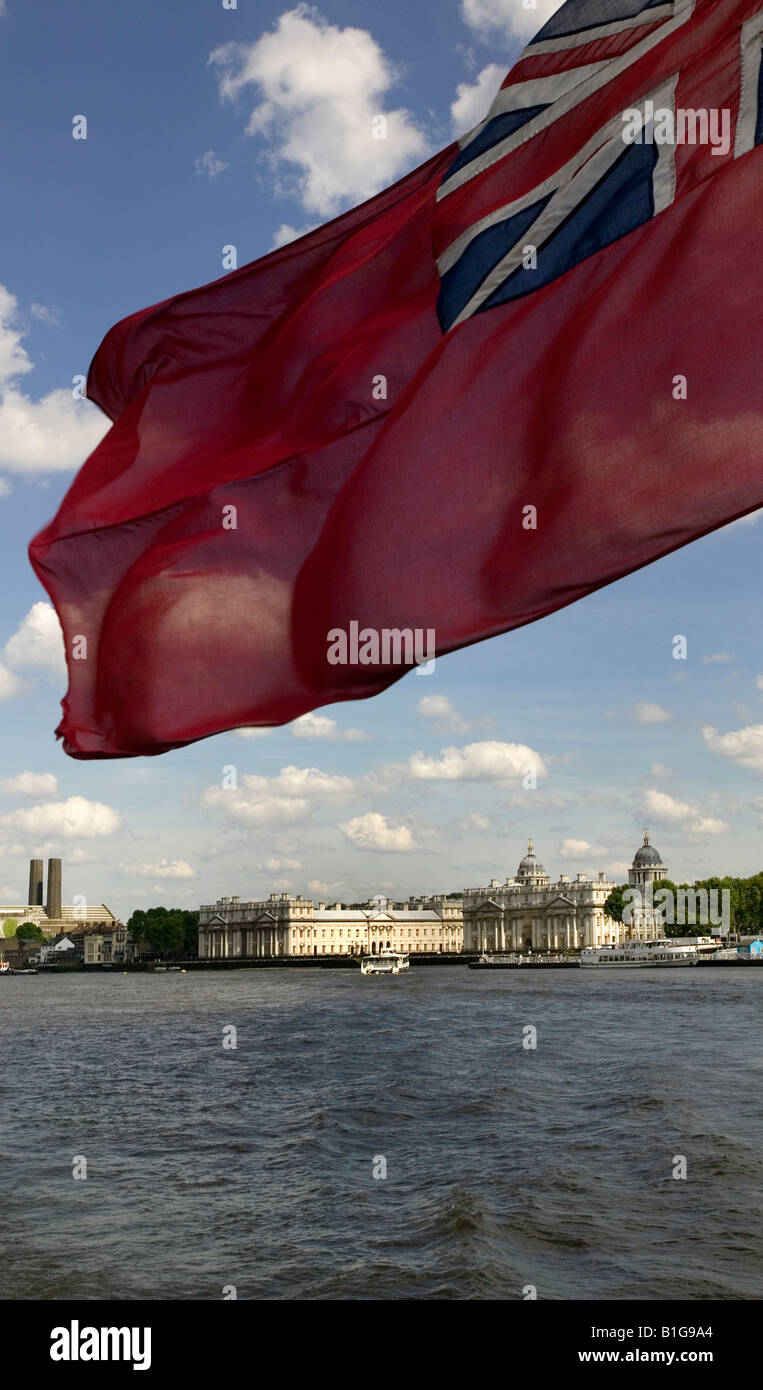 Greenwich Palace london from a boat in the River Thames Red Ensign - Stock Image