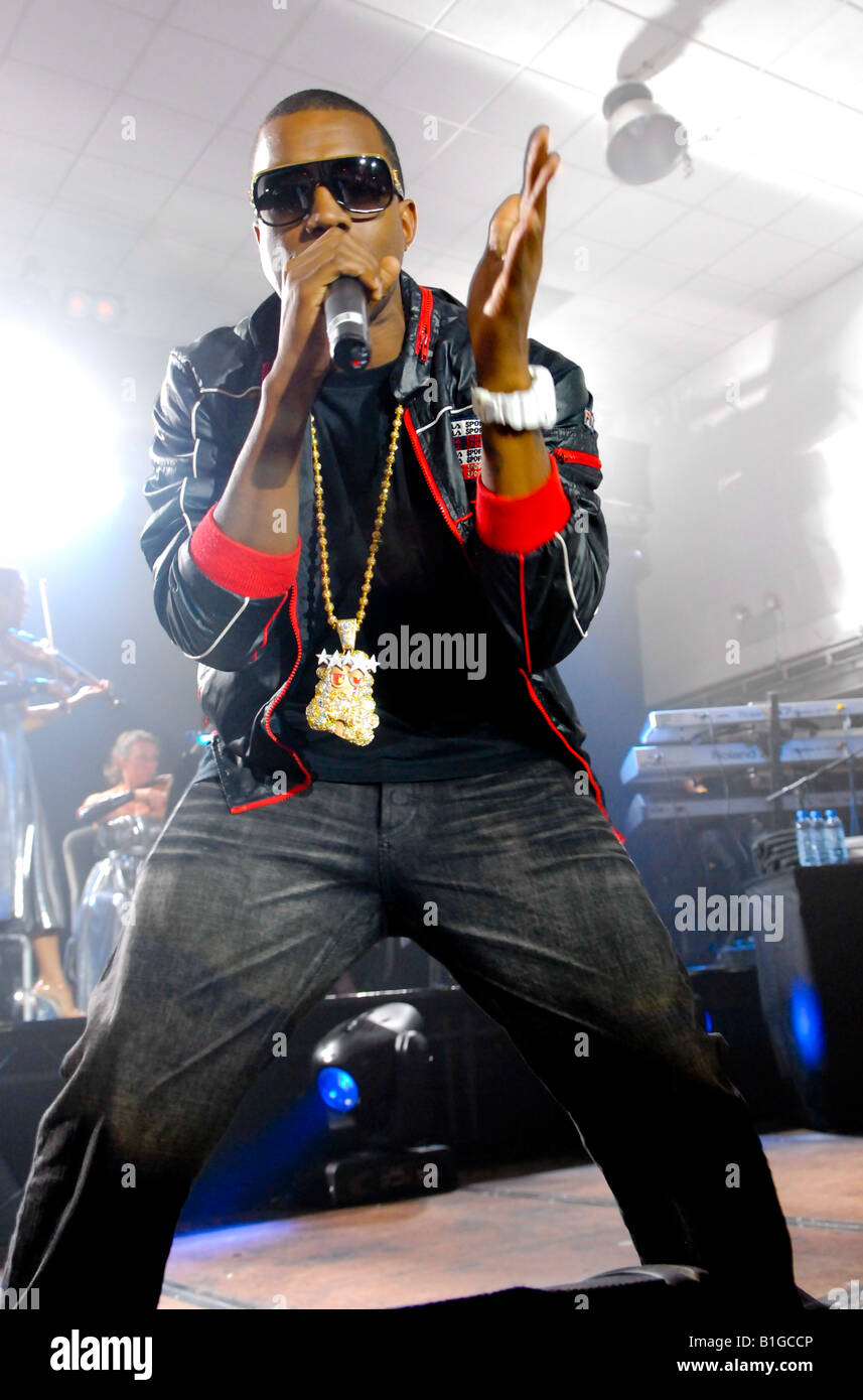 Kanye West, live music performance, stricking  a pose in gold and diamond encrusted necklass - Stock Image