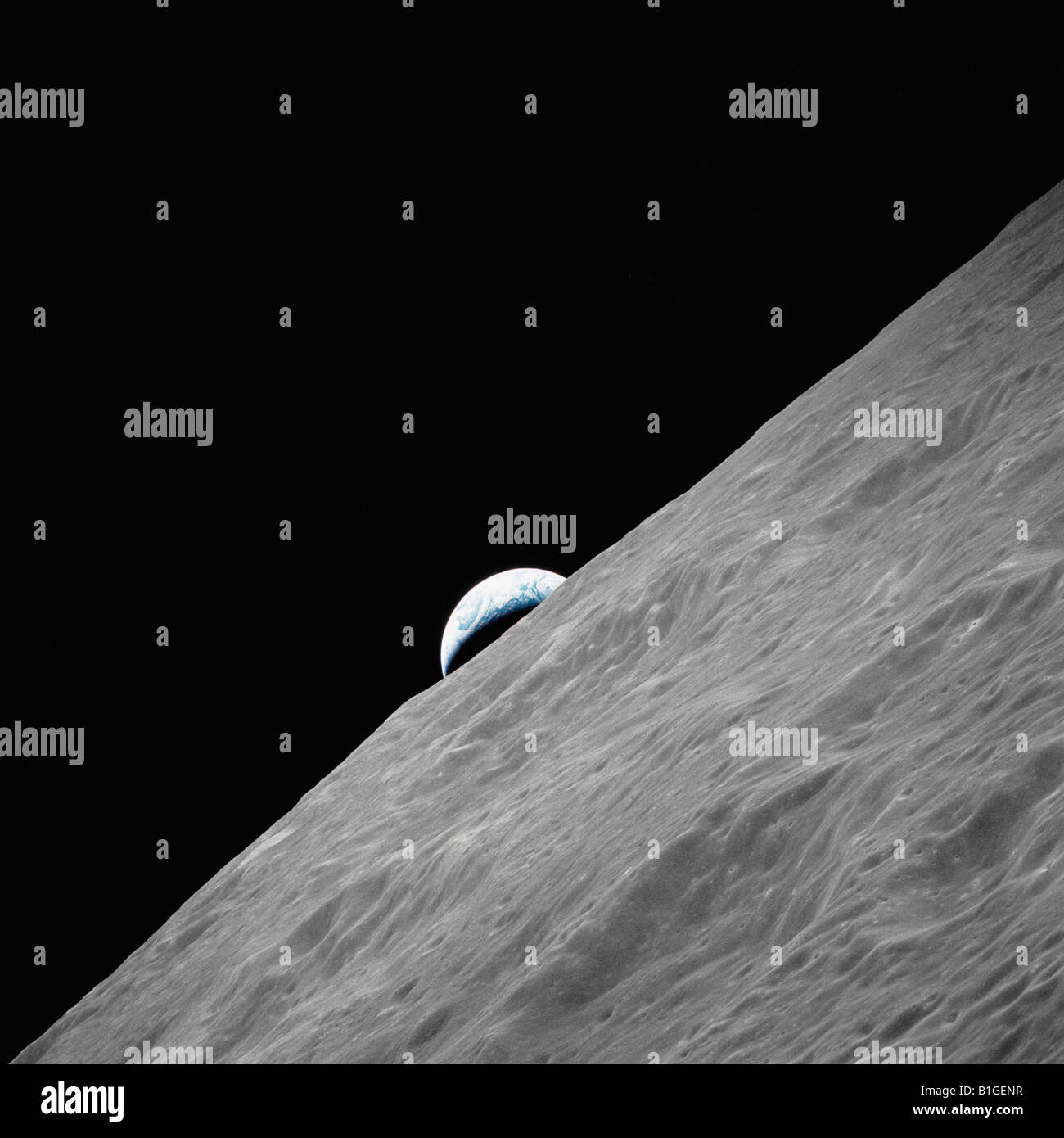 The crescent Earth rises above the lunar horizon - Stock Image