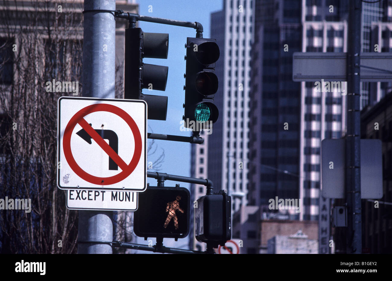 traffic light and no left turn except buses sign in San Francisco - Stock Image