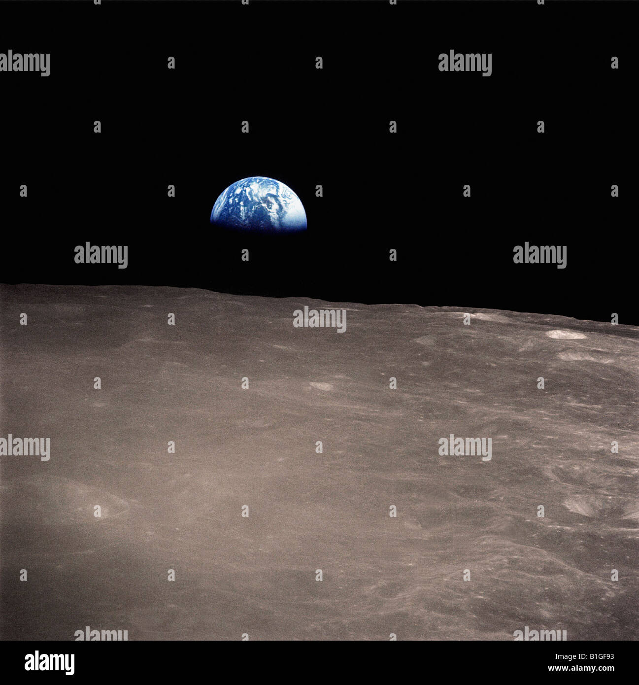 Earthrise from the surface of the moon - Stock Image