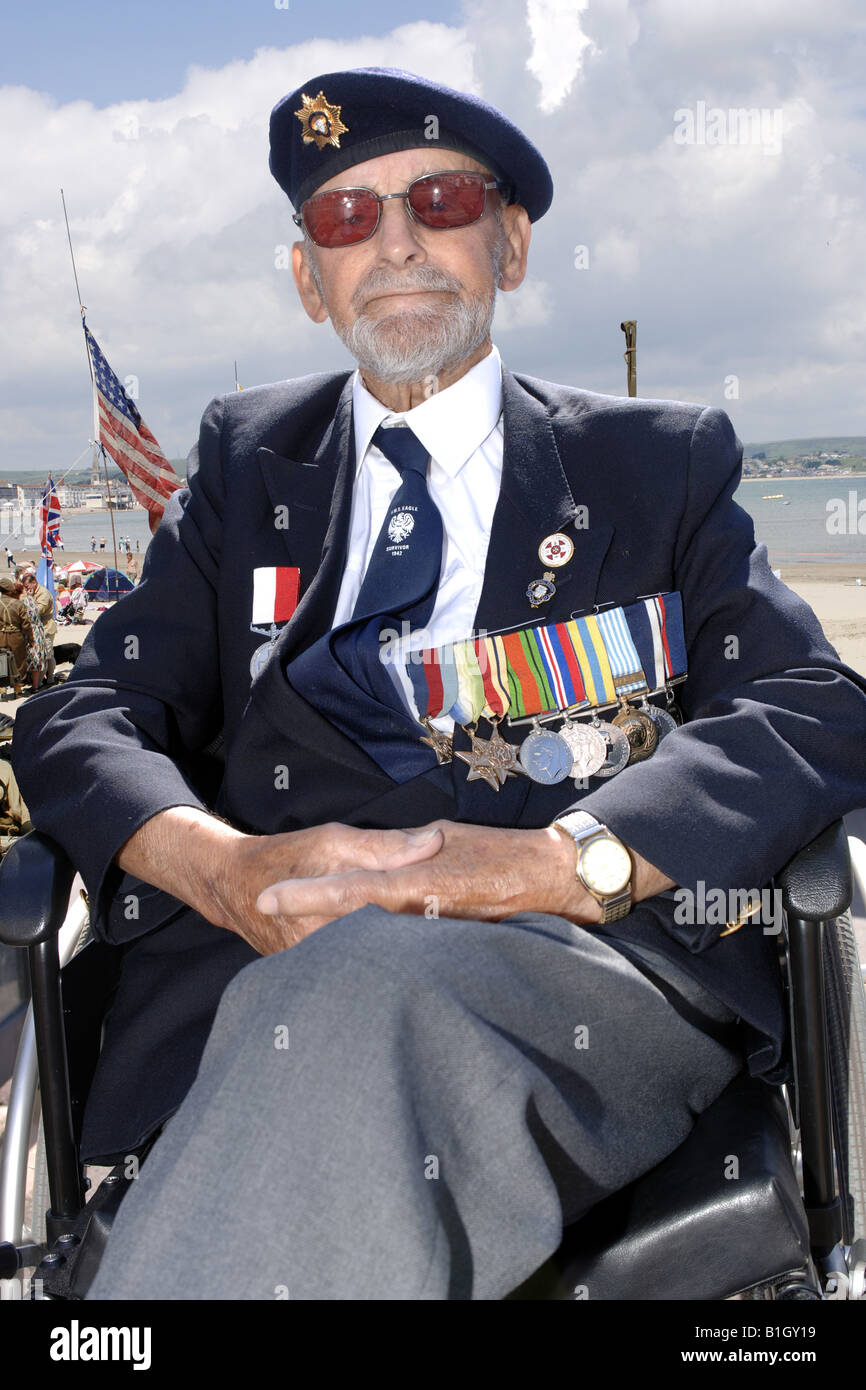 british ww2 veteran wearing his campaign medals at a summer parade