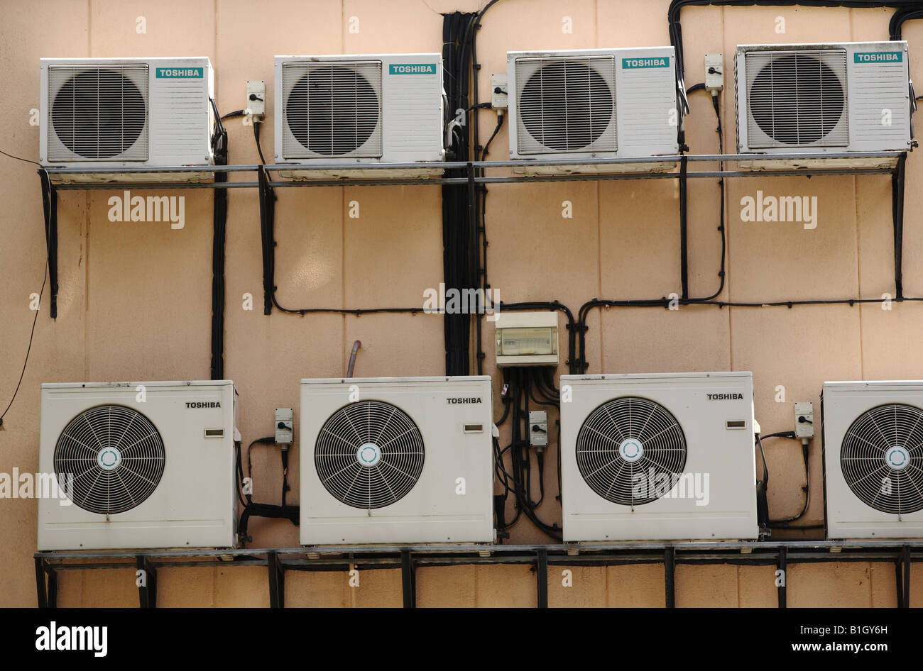 Air conditioning units on side of building. - Stock Image