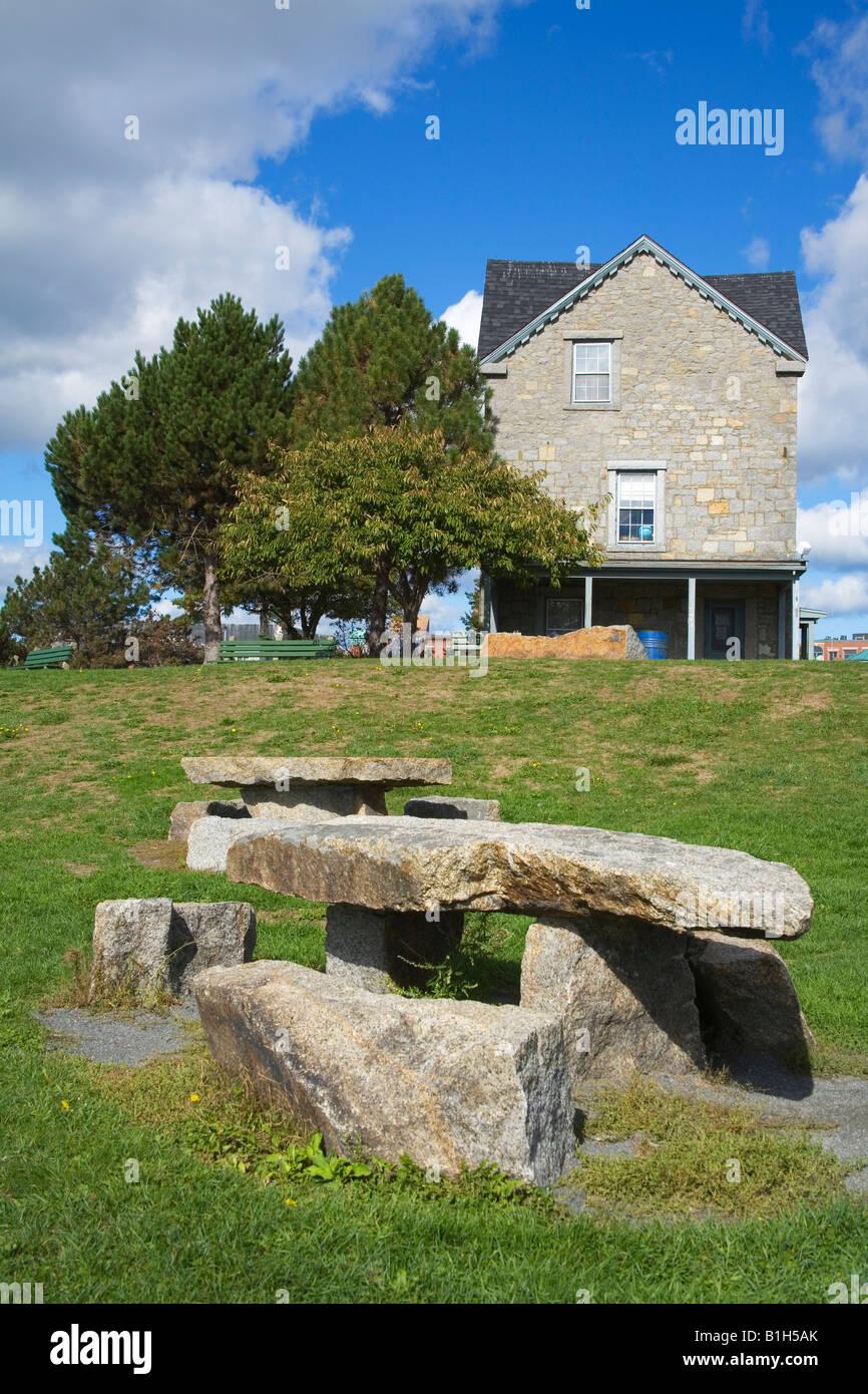 Stone bench in front of a house, Home of artist Fitz Hugh Lane, Fitz Hugh Lane Park, Gloucester, Massachusetts, - Stock Image