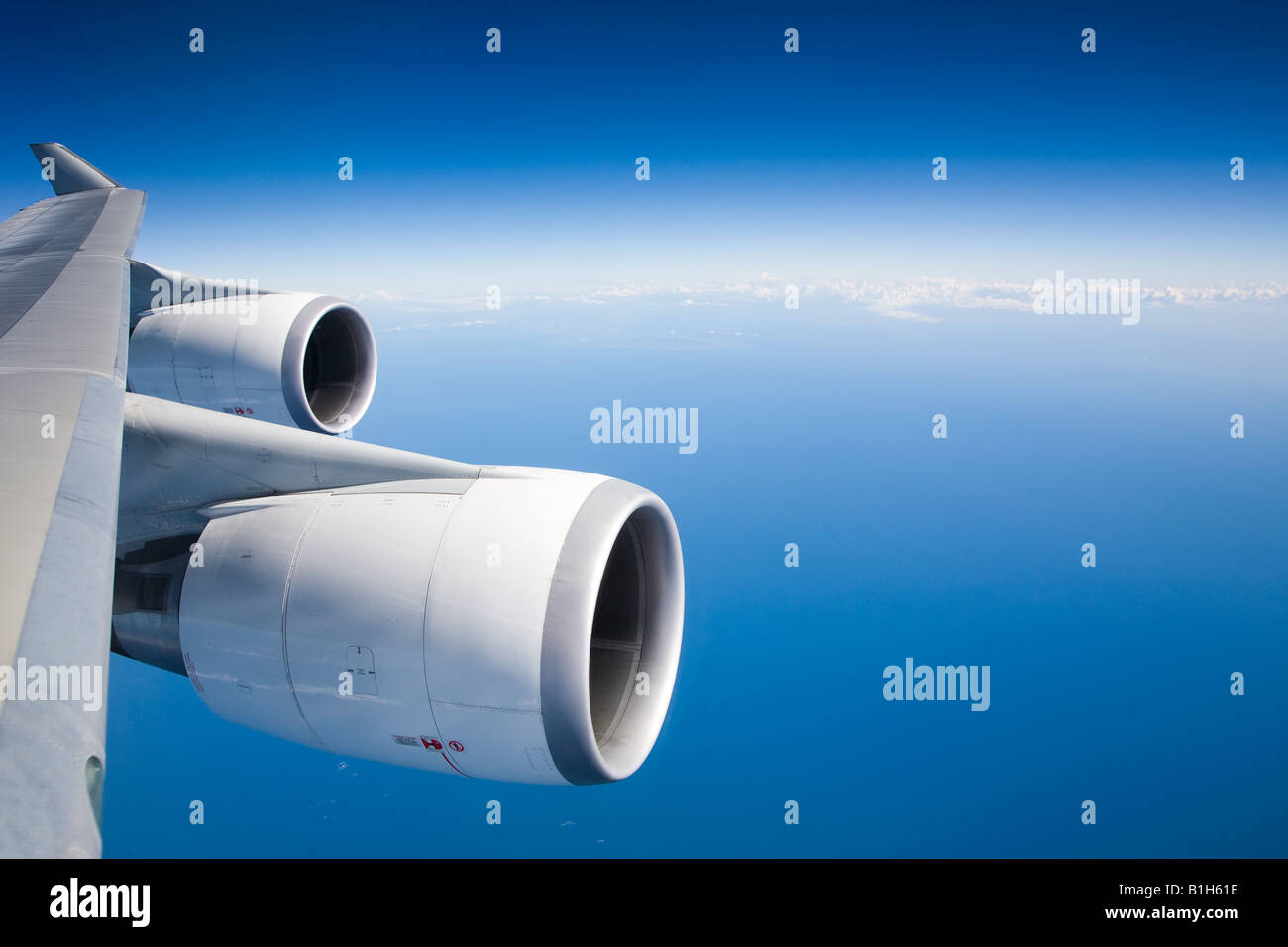 Airplane engines and blue sky - Stock Image