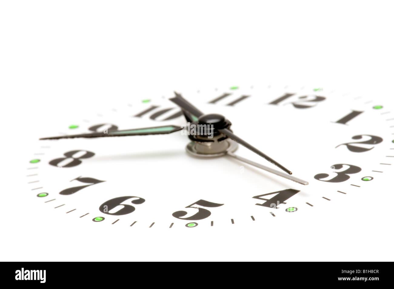 object on white clock face macro Stock Photo