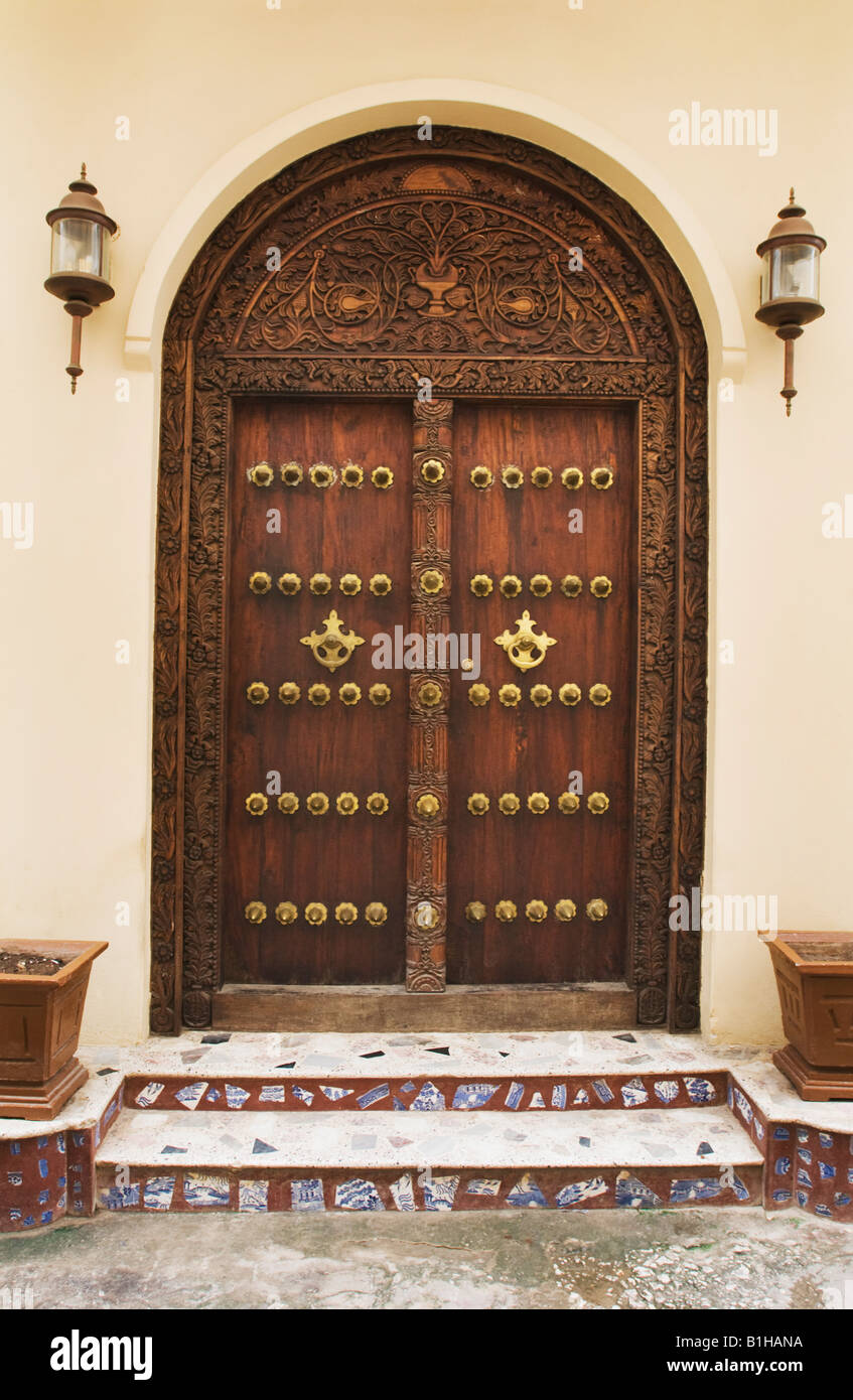 Doorway with detail of brass-studded and carving in Stonetown Zanzibar, Tanzania, East Africa. Stock Photo