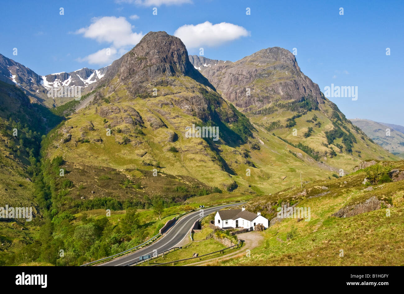 Two of The famous Three Sisters mountains in Glen Coe West Highlands Scotland with cottage - Stock Image