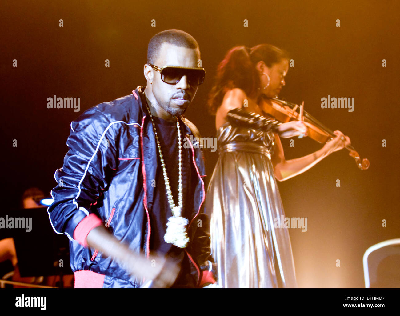 Kanye West  performing on  stage with violinist - Stock Image