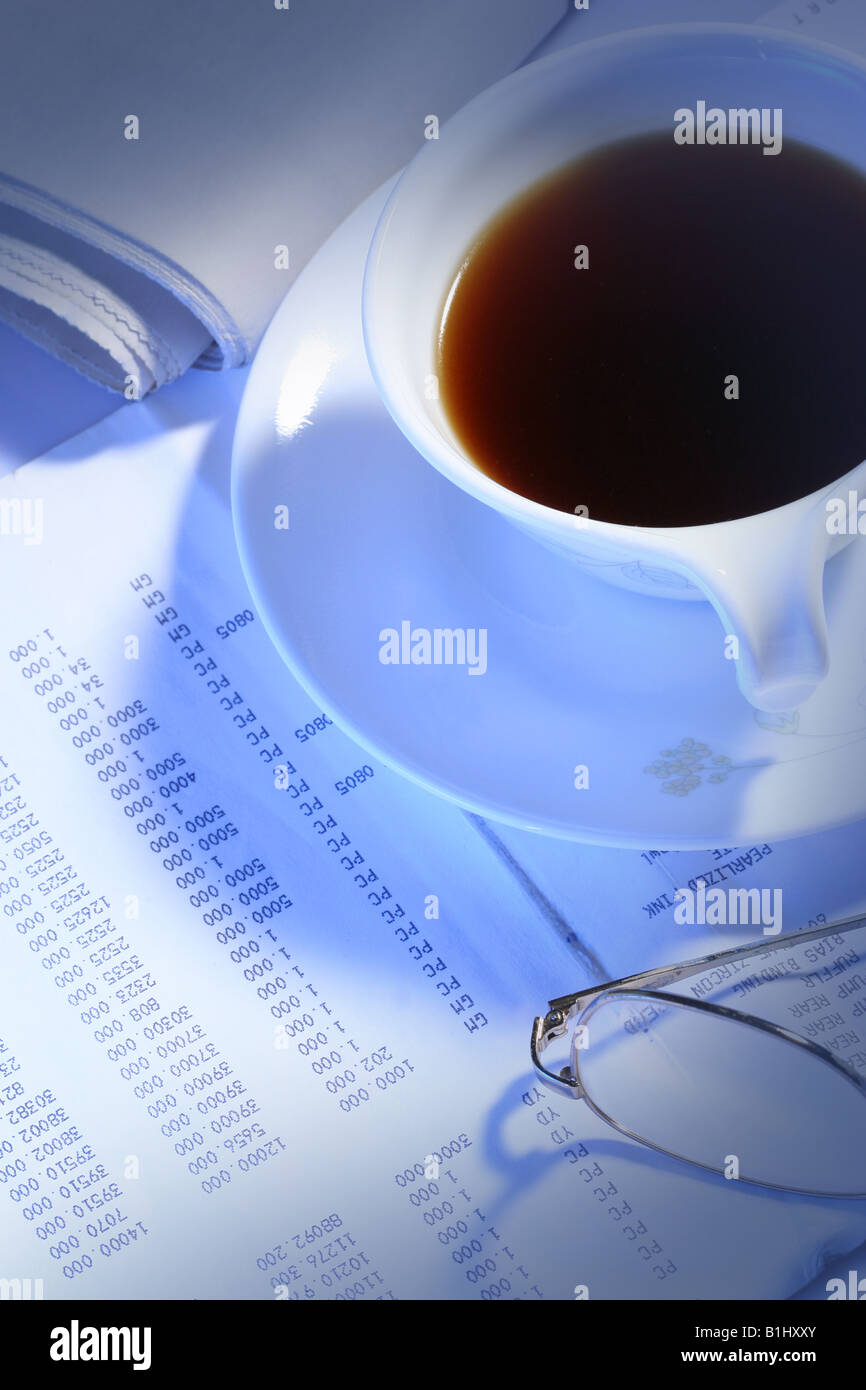 black coffee glasses and newspaper on business file Stock Photo