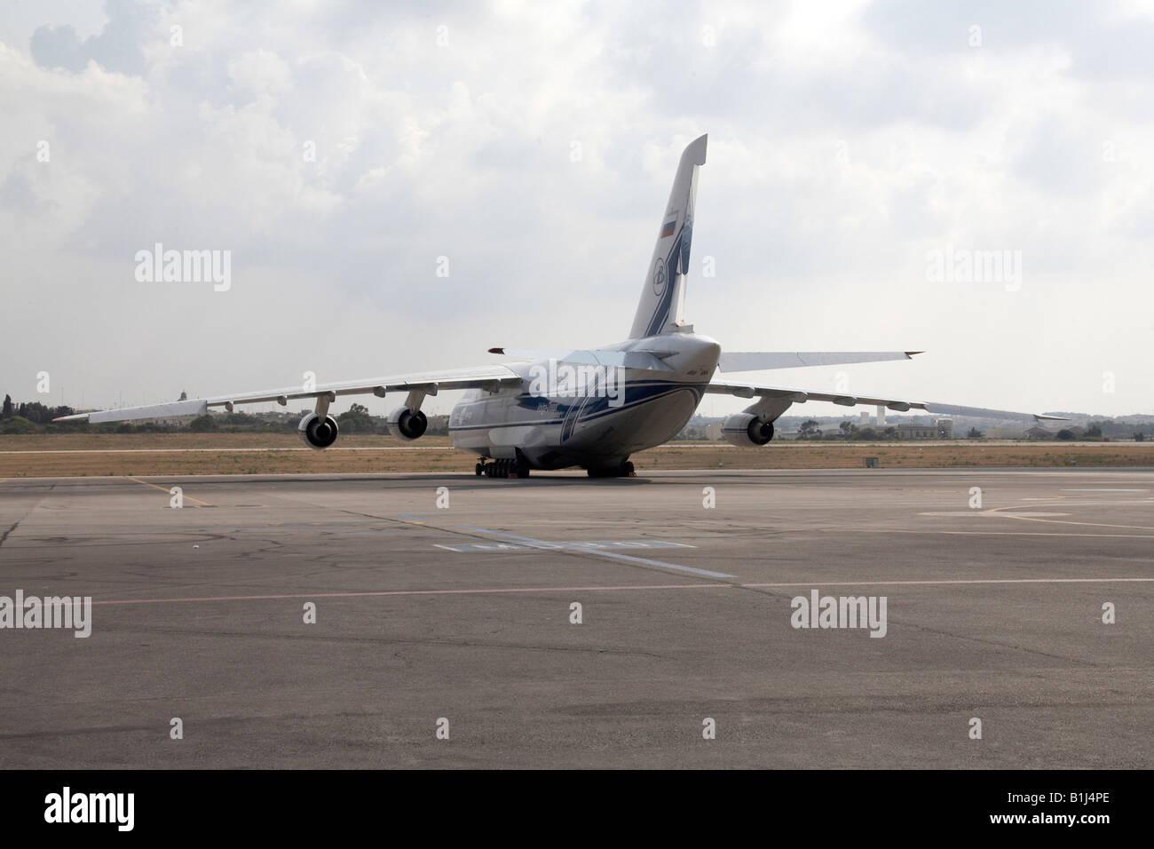 Volga Dnepr Russian Antonov AN 124 100 aircraft on apron at airport in Malta International Airport Stock Photo