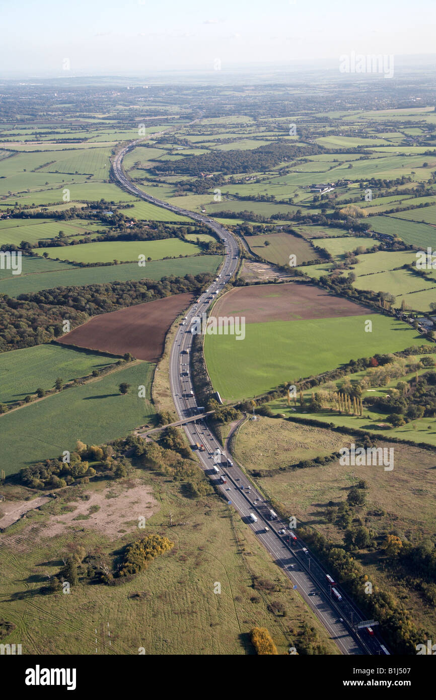Aerial view south east of M25 Motorway and country fields Brentwood London CM14 England UK - Stock Image